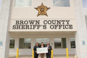 "Shelly Pakala, Express Convenience Stores, (middle) presents a check of $250 to the Crime Prevention Foundation of Brown County to Brown County Sheriff's Office Chief Deputy Todd Delain (left) and Brown County Sheriff John Gossage (right).   Express Convenience Centers donated the $250 to the Crime Prevention Foundation as a result of the ""Dashboard Dining"" contest.  Murphy in the Morning represented the Foundation with his sandwich featuring succulent oven-roasted turkey, fresh American cheese and mayonnaise on a wheat Kaiser.  Thanks to ""Murph"" and Express Convenience Centers."